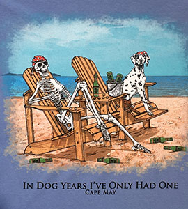 T-shirt showing a skeleton drinking beer with a Dalmation on the beach