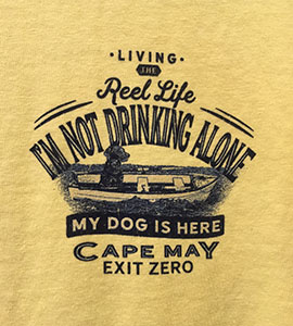 T-shirt showing a dog in a row boat